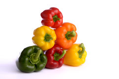 Seven pepper fruits piled Royalty Free Stock Photos