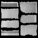 Torn papers on black Stock Images