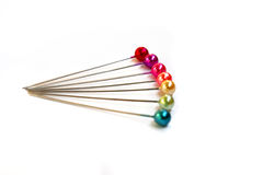 Seven pins. Seven colorful sewing pins on a white background Stock Image