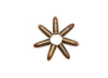 Seven-pointed star of 9mm cartridges isolated. Seven-pointed star of 9mm Parabellum cartridges isolated Stock Images