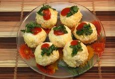 Seven rafaello on the small dish. Seven rafaello on the dish royalty free stock images