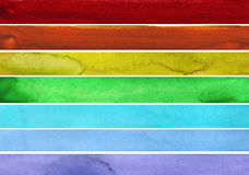 Seven rainbow colored watercolor paint strokes Royalty Free Stock Photos