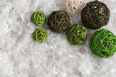 Seven rattan balls on background from feather Royalty Free Stock Photos