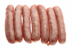 Seven raw chipolata sausages Stock Photo
