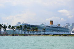 Seven Seas Cruises and Miami's Skyline. This photo was taken in Miami. Miami, at Florida's southeastern tip, is a vibrant city whose Cuban influence is reflected Stock Images