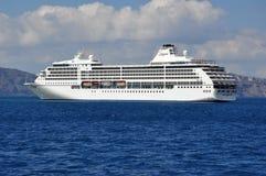 Seven Seas Mariner. Regent Seven Seas Mariner, luxury cruise ship anchored in Santorini, Greece Royalty Free Stock Photography
