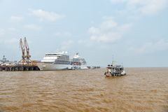 Seven Seas Navigator cruise liner in dock and small ship. Santarem, Brazil - December 02, 2015: Seven Seas Navigator cruise liner in dock and small ship floating Stock Photos