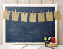 Seven sheets of paper hanging and blackboard Royalty Free Stock Photos