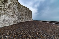 Seven Sisters Beach, East Sussex, England. Seven Sisters Beach with cloudy sky, East Sussex, England Stock Image