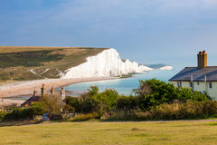Seven Sisters Chalk cliffs from Seaford Head. The Seven Sisters Chalk cliffs and the coastguard cottages, from Seaford Head South Downs East Sussex England UK royalty free stock images