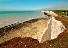 Seven Sisters Cliffs. The Seven Sisters are a series of chalk cliffs by the English Channel. They form part of the South Downs in East Sussex, between the towns Royalty Free Stock Images