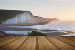 Seven Sisters sunrsie viewed from Seaford Head with wooden plank Stock Photos