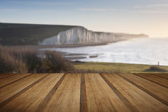 Seven Sisters sunrsie viewed from Seaford Head with wooden plank Royalty Free Stock Photo