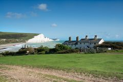 Seven Sisters in Sussex. Coastguard cottages with the Seven Sisters cliffs in the background at Seaford Head on the Sussex coast stock images