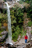 Seven Sisters Water Falls, Menrong Gong, North Sikkim. A tourist is enjoying the Seven Sister waterfalls; a prominent spot for tourist travelling to Mangan is Stock Images