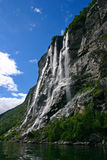 Seven Sisters Waterfall. The Geiranger fjord is one of Norway's most visited tourist sites and has been listed as a UNESCO World Heritage Site Royalty Free Stock Photo