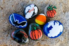 Seven painted small rocks for Halloween Royalty Free Stock Photography
