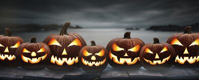 Free Seven Spooky Halloween Pumpkins, Jack O Lantern, With An Evil Face And Eyes Stock Image - 196394671