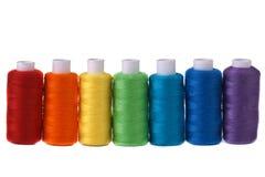 Seven spools rainbow colors Royalty Free Stock Photos