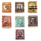 Seven Stamps of US Presidents. Seven old US postal stamps of seven US presidents: William Harding, William McKinley, Ulysses Grant, Groover Cleveland, Rutherford Royalty Free Stock Photos