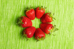Seven strawberries in circle Stock Images