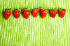 Seven strawberries in a row Stock Photo