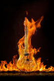Seven-string guitar on fire Stock Image
