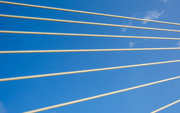 Seven strings. Blue sky. Cables strained. Clouds. Seven strings. Hawser. Rope in the sky. Tow in the sky stock photo