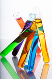 Test tubes with colored liquid in the spectrum colors on a white Royalty Free Stock Photo