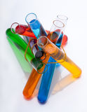 Test tubes with colored liquid in the spectrum colors on a white Stock Images