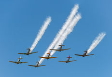 Seven AT-6 Texans With Smoke Trails Royalty Free Stock Image