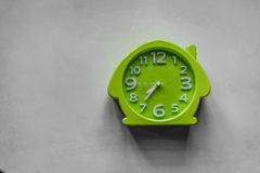 Seven thirty five. A shot of a green clock showing 0735 in the morning Stock Image