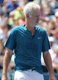 Seven times Grand Slam Champion John McEnroe in action during 2018 US Open exhibition match at newly open Louis Armstrong Stadium. NEW YORK - AUGUST 22, 2018 royalty free stock photography
