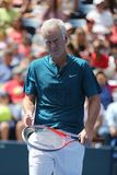 Seven times Grand Slam Champion John McEnroe in action during 2018 US Open exhibition match at newly open Louis Armstrong Stadium. NEW YORK - AUGUST 22, 2018 stock photo