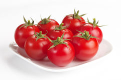Seven tomato cherry. Seven fresh tomato cherry macro shot isolated over white background Royalty Free Stock Photography