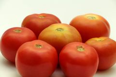 Seven Tomatoes in hexogan shape. Seven Tomatoes arranged in hexagonal shape one in center and other six in hexagonal shape in close up shot in 45 degree angle Royalty Free Stock Photography