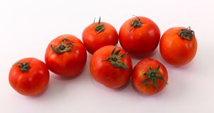 Seven tomatoes on white. Seven fresh tomatoes on white , healthy food, vegetarian Royalty Free Stock Photo