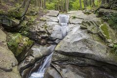 Seven Tubs Waterfall Rocky Forest Stream. Small waterfall in the mossy, rocky stream at beautiful Seven Tubs Nature Area in Pennsylvania. Water flows down Royalty Free Stock Photo