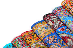 Seven varicoloured carpets add together in rouleau Stock Photos