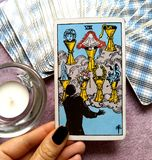 The Seven VII of Cups Tarot Card. This card is about Priorities Integration Enlightenment Meditation Imagination Daydreaming Fantasies Illusions and royalty free stock photo