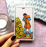 The Seven VII of Pentacles Tarot Card. This card is about Harvest Time, Rewards, Results, Profit, Payouts, Dividends, Shares, Bonus, Benefits and Large stock photo