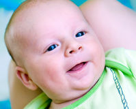 Seven week baby smile. Happy seven week baby smiling on mother's laps royalty free stock images