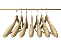 Seven wood hangers isolated on the white background Royalty Free Stock Images