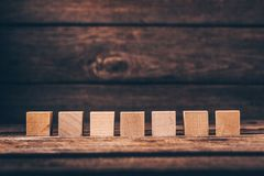 Wooden Cubes on Wood Background stock images