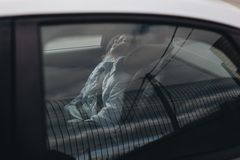 Seven-year charming girl sleeping in a children`s car seat stock photography