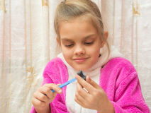 Seven-year girl on stack makes drawing Crafts from clay Stock Images