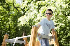 Seven-year-old boy on the Playground stock photography