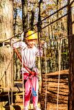 Seven year old girl in Adventure Park. Little girl is climbing in the adventure park Royalty Free Stock Photos