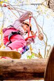 Seven year old girl in the Adventure Park. Little girl is climbing in the adventure park stock photography