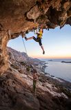 Seven-year old girl climbing a challenging route Royalty Free Stock Photos